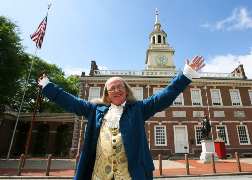 Actor portrays Benjamin Franklin in front of Independence Hall